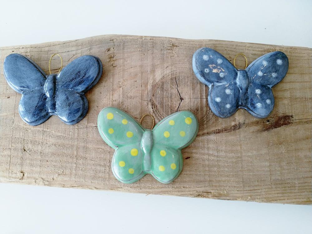 ceramic-butterflies-on-wood