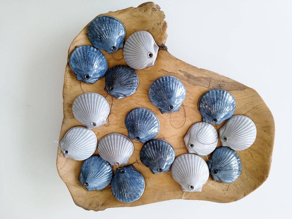 ceramic-scallop-shells-on-wood